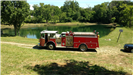 Fire truck parked by a lake