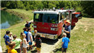 Firefighters talking to kids by a firetruck