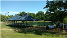 Large tent and table for food set up by the lake