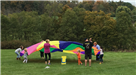 Kids and Adults Playing with Parachute