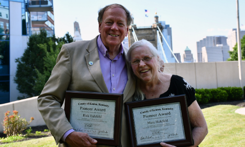 Mary Hulefeld and Rick Hulefeld hold their Pioneer Award plaques.
