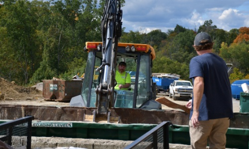 Public Works employee operates heavy machinery at Fall Clean-Up
