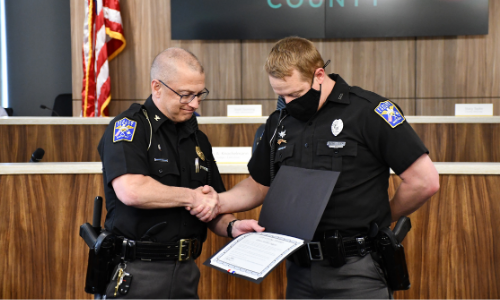 Michael Allgeier receives award from Chief Jones